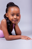 Cute little African American girl smiling Stock Photos