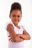 Cute little African Asian girl with folded arms. Cute little African Asian girl smiling ,with folded arms stock photography