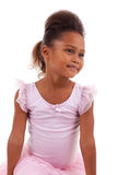 Cute little African Asian girl with folded arms Stock Image