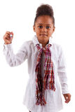 Cute little African Asian girl holding a pen Royalty Free Stock Photography