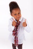 Cute little African Asian girl  making thumbs up Royalty Free Stock Image