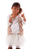 Cute little African Asian girl making  thumbs up gesture  isolat Royalty Free Stock Images