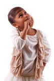 Cute little African Asian girl thinking Stock Image