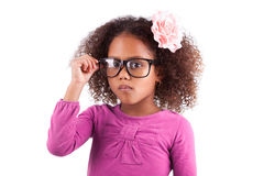 Cute little African Asian girl wearing glasses Stock Photos