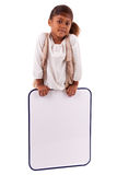 Cute little african girl holding a whiteboard Stock Photos