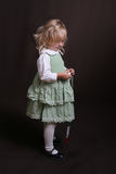 Cute little angel in green dress Stock Photos