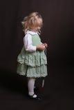 Cute little angel in green dress. Little girl standing Stock Photos