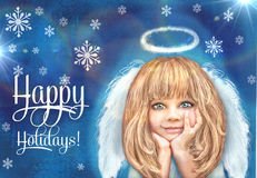 Cute little angel. Happy smiling angel girl with blond hair and white wings isolated on a grunge blue background with snowflake. Royalty Free Stock Photo