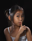 Cute little asia girl. In mood lighting with black background royalty free stock photography