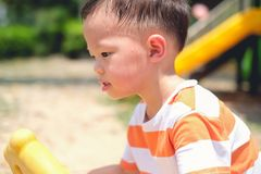 Free Cute Little Asian 2 - 3 Years Old Toddler Boy Child Sweating During Having Fun Playing, Exercising Outdoor At Playground, Heat Stock Photo - 167654590