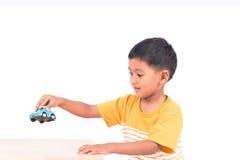 Cute little asian boy child kid preschooler playing  car Stock Image