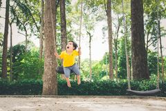 Cute little asian boy in a park on a nice day outdoors.  Stock Photo