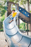 Cute little asian boy in a park on a nice day outdoors Royalty Free Stock Photos