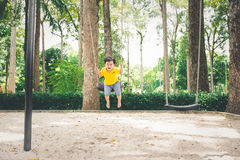 Cute little asian boy in a park on a nice day outdoors royalty free stock image