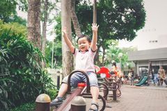 Cute little asian boy in a park on a nice day outdoors Royalty Free Stock Photo