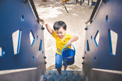 Cute little asian boy in a park on a nice day outdoors.  Royalty Free Stock Photos