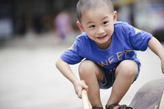 Cute little asian boy Squatting Royalty Free Stock Photos