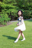 A cute little asian girl. In playing happily in the garden Stock Photography