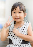 Cute little asian girl in doctor costume. Royalty Free Stock Photo