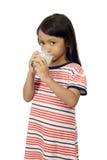 Cute Little Asian Girl Drinking Milk Stock Photography