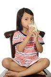 Cute Little Asian Girl Drinking Milk Stock Image
