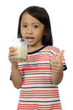 Cute Little Asian Girl Drinking Milk Stock Images