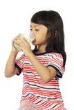 Cute Little Asian Girl Drinking Milk Royalty Free Stock Photo