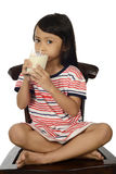Cute Little Asian Girl Drinking Milk Royalty Free Stock Image