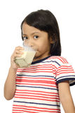 Cute Little Asian Girl Drinking Milk Royalty Free Stock Photography
