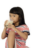 Cute Little Asian Girl Drinking Milk Stock Photo