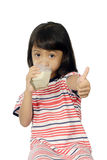 Cute Little Asian Girl Drinking Milk Stock Images