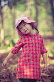 Cute little asian girl playing in beautiful outdoor autumn. Stock Image