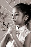 Cute little asian girl in sepia. Image of a cute little girl with umbrella stock image