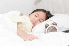Cute little asian girl sleep and hug doll on bed Royalty Free Stock Photos