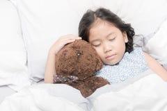 Cute little asian girl sleep and hug teddy bear Stock Photography