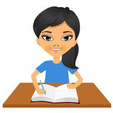 Cute little asian student girl writing. Portrait of cute little asian student girl writing something and smiling happy sitting at the desk Stock Photos