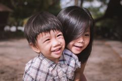 Cute Little Asian Young and cheerful brother and sister. The Asian brothers hugged each other with love and fun to express their warm family Stock Images