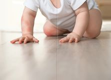 Cute little baby before and after allergy treatment crawling on floor indoors. Closeup stock photo