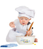 Cute little baby baking biscuits Stock Photo