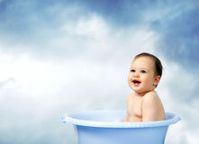 Cute little baby bathed in a bath.Outdoor royalty free stock photos