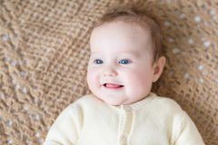 Cute little baby with blue eyes wearing warm sweater Stock Photos