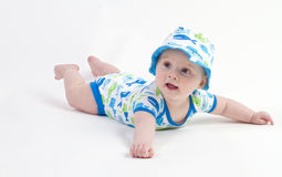 Cute little baby boy. A cute little Caucasian baby boy (six month old) on his tummy royalty free stock photography
