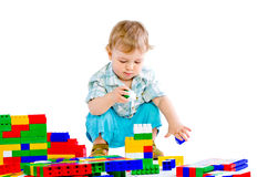 Cute little baby boy with colorful building block Stock Photos