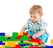 Cute little baby boy with colorful building block Royalty Free Stock Photos