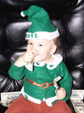 Cute little baby boy and dollars Stock Images