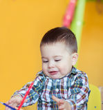 Cute little baby boy drawing with colorful pencils Royalty Free Stock Images