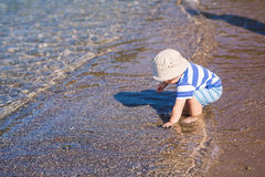 Cute little baby boy exploring the beach Royalty Free Stock Image