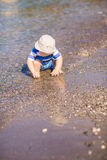 Cute little baby boy exploring the beach Stock Images