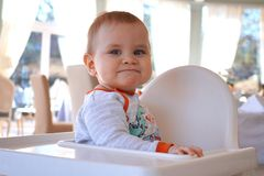 Cute little baby boy with a funny expression on his face royalty free stock image