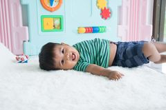 little baby boy lying on soft blanket stock images